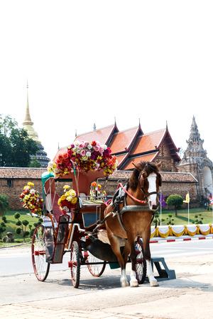cartage: Horse carriage at Phrathat Lampang Luang temple in Lampang, Thailand