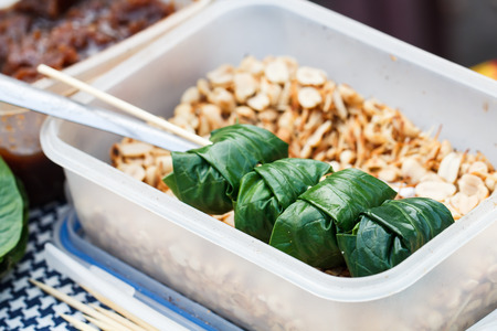 Food wrapped in leaves or Miang Kham sold as local market, Thailand-4 photo