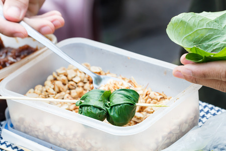 Food wrapped in leaves or Miang Kham sold as local market, Thailand-6 photo