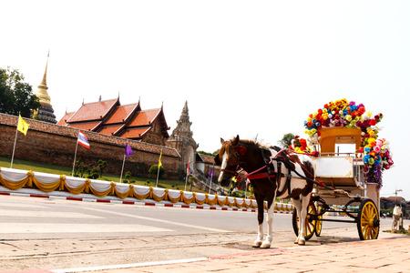 cartage: Horse carriage at Phrathat Lampang Luang temple in Lampang, Thailand-5 Stock Photo