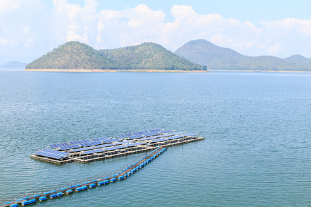 Solar panels on the water on daytime photo