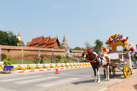 Horse carriage at Phrathat Lampang Luang temple in Lampang, Thailand photo