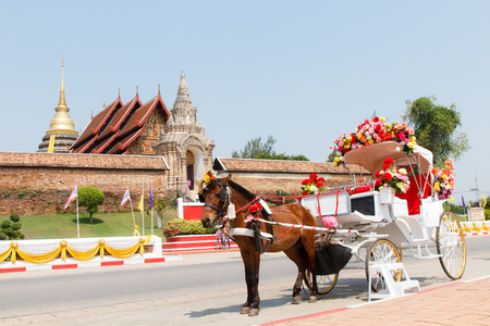 horse and carriage: Horse carriage at Phrathat Lampang Luang temple in Lampang, Thailand-2