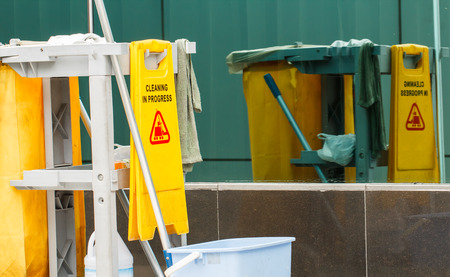 building maintenance: Mop bucket and wringer cleaning in process Stock Photo