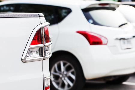 multi story: Back light car in parking lot