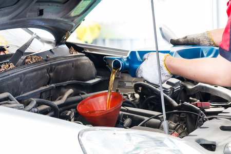 oil change: Car change engine oil and hand worker