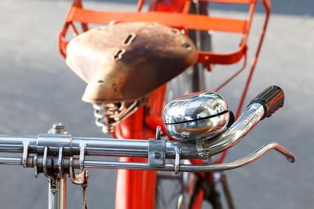 handlebars: Closeup of red bicycle bell-2