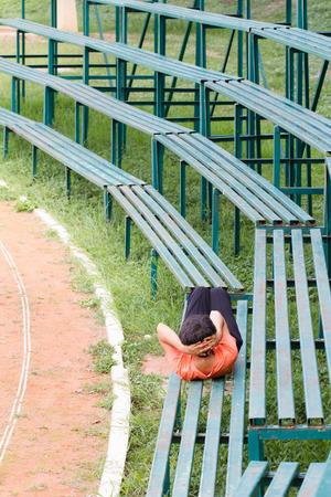 senior woman exercising: Senior woman exercising in the Soccer field Stock Photo