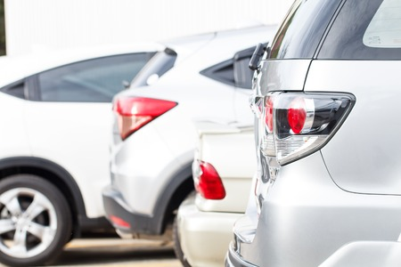 motor vehicle: Closeup car park in parking lot