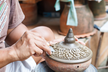 Hands of craftspeople do a clay pot at Koh Kred in Nonthaburi province, Thailand Stock Photo
