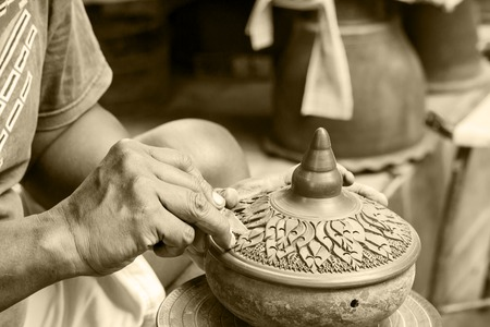 NONTHABURI , THAILAND -AUGUST 8 2015: Hands of craftspeople do a clay pot. Photo at local market Koh Kred Nonthaburi, thailand.