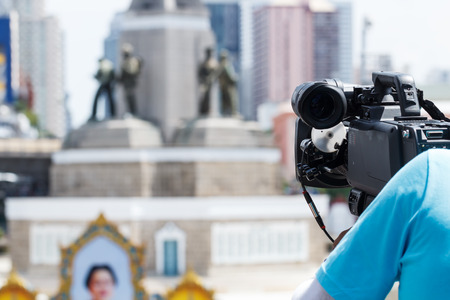 definition high: High Definition TV camera with man working outdoor