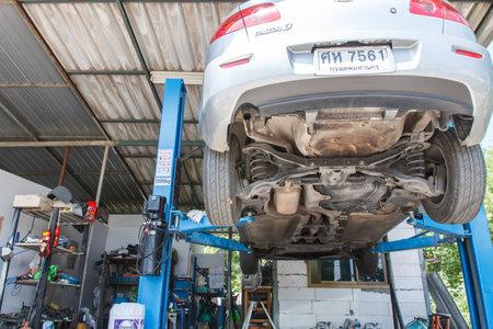 car repair shop: NONTHABURI , THAILAND -JULY 11 2015: Private car. Mazda 3 with orbital polisher in auto car repair shop. Photo at local repair shop Nonthaburi, thailand. Editorial