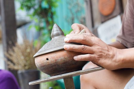nonthaburi province: Hands of craftspeople do a clay pot at Koh Kred in Nonthaburi province, Thailand Stock Photo