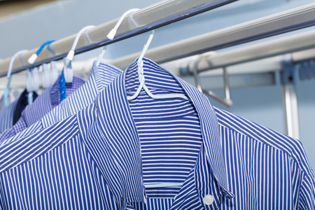 drycleaning: Close-up of blue shirt wait for dry during daytime