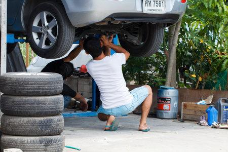 orbital: NONTHABURI , THAILAND -JULY 11 2015: Private car. Mazda 3 with orbital polisher in auto car repair shop. Photo at local repair shop Nonthaburi, thailand. Editorial