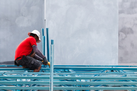 skilled operator: SATUN , THAILAND -AUGUST 28 2015: Construction worker working on construction site. Photo from koh Lipe Satun, thailand. Editorial