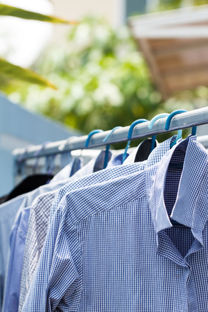 Dryclean blue shirt wait for dry during daytime