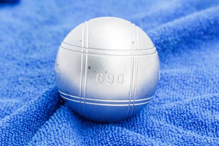 petanque: Metallic petanque ball on the blue background-2 Stock Photo