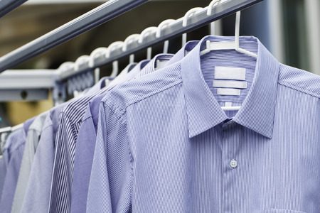 drycleaning: Man shirt wait for dry after cleaning clothes on daytime