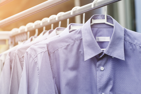 drycleaning: Blue shirt wait for dry after cleaning clothes on daytime Stock Photo