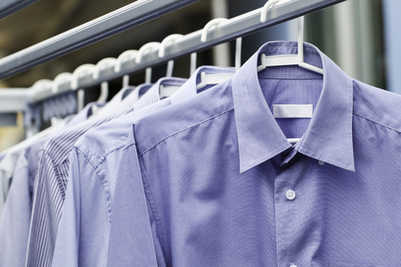 drycleaning: Blue shirt wait for dry after cleaning clothes Stock Photo