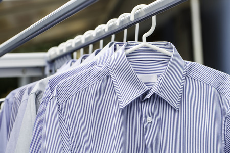 drycleaning: Man shirt wait for dry after cleaning on daytime Stock Photo