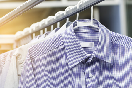 Man shirt wait for dry after cleaning on daytime Standard-Bild