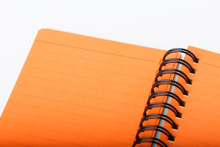 Open orange color notebook with line pages Stock Photo