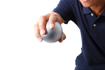 bocce ball: Man with blue shirt and petanque ball in hand isolated on white background Stock Photo