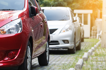 valet: Red car parking in line outdoor Stock Photo