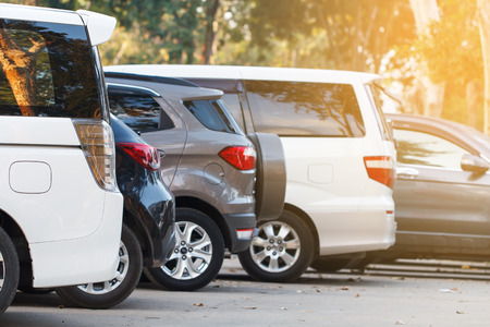 White car parking lot on daytime Stock Photo
