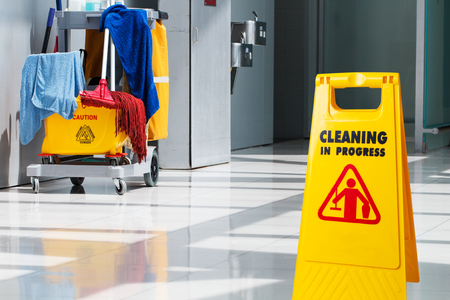 Janitorial and mop bucket on cleaning in process