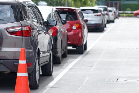 Car parking in line behide traffic cone