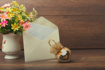 Heart Shaped Gift With Yellow Invitation Card And Flower Vase