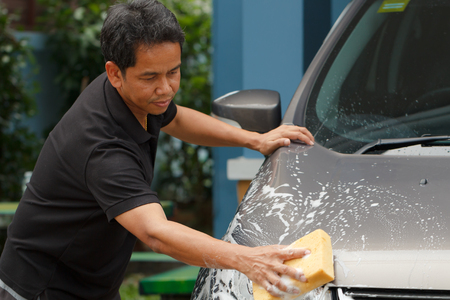 mirror: Worker car washing in the car wash shop service Stock Photo