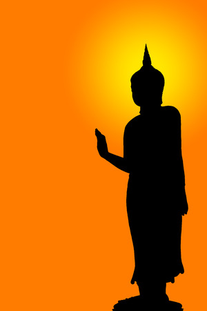 The silhouette of a Buddha image with light of intellectual bliss represents the peace and the attachment of the Buddhist people. Reklamní fotografie