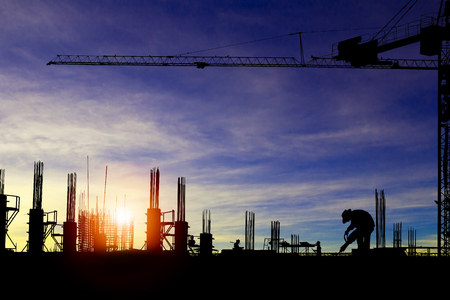 Silhouette images of construction sites are underway and workers are working.