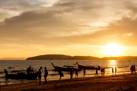 aonang: Silhouette people on beach when sunset time at ao nang bay in Krabi province, Thailand
