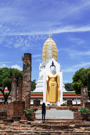 Buddhists worshiping the statues of the great Buddha in the daytime