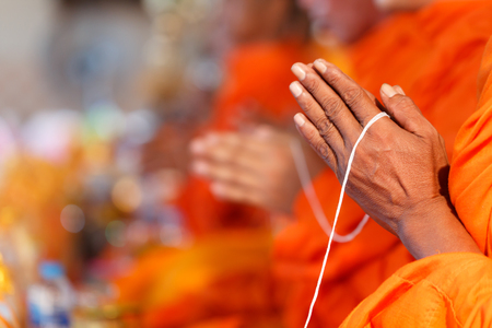 Buddhist priests praying for sacred ceremonies according to Buddhist religious traditions Stock Photo