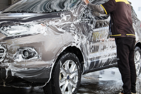 microfiber: Worker washing car at the car wash shop to clean up dirt and keep the health of the driver and passengers