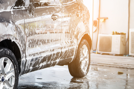 Car washing at the car wash shop to clean up dirt and keep the health of the driver and passengers