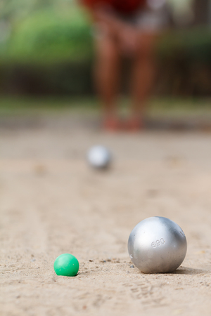 Boules and green jack ball in the match