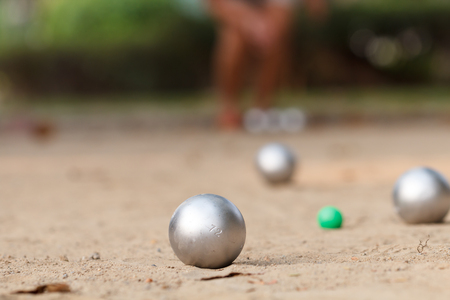 Boules ball in the match with player in back