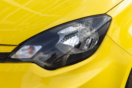 Yellow car headlights closeup photos 스톡 콘텐츠