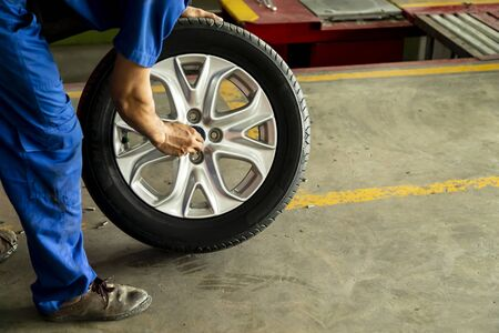 Employee worker prepair tires for waiting to change wheel car at the repair shop.