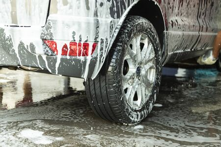 Car washing at the car wash shop to clean up dirt and keep the health of the driver and passengers.