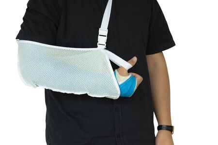 Close up man hand with blue bandage as arm injury isolated on white background and copy space. Health-care concept. Banque d'images - 130980827
