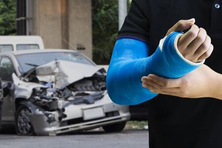 Close up man holding hand with blue bandage as arm injury concept with car accident, Banque d'images - 130980828